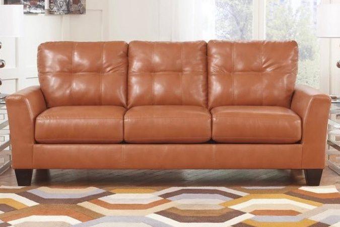 Ashley Furniture Paulie Leather Sofa in Orange | BestHomeHQ.com